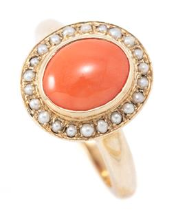 Sale 9169 - Lot 377 - A 9CT GOLD CORAL AND PEARL CLUSTER RING; centring an oval cabochon coral to surround of 22 seed pearls, size N1/2, top 14 x 12.5 mm,...