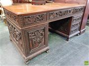 Sale 8559 - Lot 1079 - Probably Straits Chinese Carved Teak Twin Pedestal Desk, profusely carved with garden scenes, fitted with six drawers & panel door,...