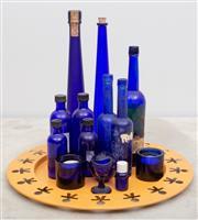 Sale 8644A - Lot 79 - A quantity of blue glass bottles containing 1/4 of a litre of Italian liqueur, C&E Mortoron Limited England (possible castor oil/cod...