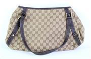 Sale 8837 - Lot 330 - A VINTAGE GUCCI MONOGRAM ABBEY SHOULDER BAG; monogram canvas and brown leather straps with gilt metal hardware, internal tag no. 130...