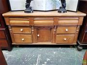 Sale 8598 - Lot 1062 - Victorian Pine Welsh Dresser, with central panel door flanked by seven drawers & turned brackets