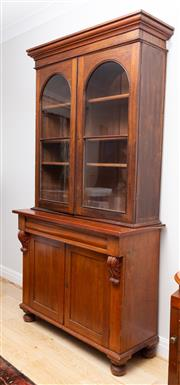 Sale 8644A - Lot 42 - A C19th Cedar Bookcase with two glazed doors opening to display a shelved interior, above a cupboard base H 225 x L 120 x D 47cm.