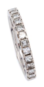 Sale 9083 - Lot 387 - AN 18CT WHITE GOLD HALF HOOP DIAMOND RING; set with 15 princess cut diamonds totalling approx. 0.60ct, size L1/2, width 2.6mm, wt. 3...