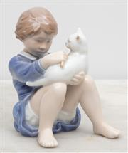 Sale 8644A - Lot 80 - A Royal Copenhagen Figure of a girl with a kitten, height 15cm.