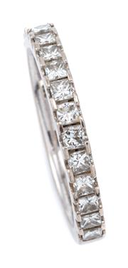 Sale 9083 - Lot 389 - AN 18CT WHITE GOLD HALF HOOP DIAMOND RING; set with 15 princess cut diamonds totalling approx. 0.60ct size L 1/2, width 2.6mm, wt. 3...