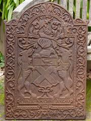 Sale 8568A - Lot 8 - An antique style cast iron fireplace back plate modelled with an armorial, H 75cm