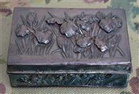 Sale 8963H - Lot 26 - A Japanese Meiji/Taisho chased silver box with orchids in high relief, no mark found, with dents and solder marks, Length 15cm weigh...