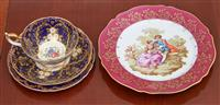 Sale 9080H - Lot 25 - A Limoges plate depicting courting couple after Fragonard featuring a puce and gilt border together with an Aynsley cup saucer plate...