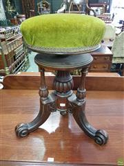 Sale 8617 - Lot 1028 - Victorian Carved Walnut Piano Stool, with green velvet revolving seat on centre pedestal
