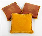 Sale 8703A - Lot 13 - Three Versace cushions in claret and gold