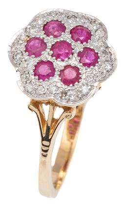 Sale 9115 - Lot 363 - A RUBY AND DIAMOND CLUSTER RING; set in 9ct gold with 7 round cut treated rubies to scalloped surround of 24 round brilliant cut dia...