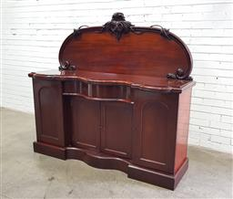 Sale 9137 - Lot 1009 - Victorian Mahogany Sideboard, with carved back, the central serpentine section with a drawer & two panel doors, flanked by taller ar...