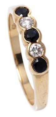 Sale 8982 - Lot 333 - A 9CT GOLD SAPPHIRE AND DIAMOND RING; part rub set with 3 dark blue sapphires adjacent to 2 round brilliant cut diamonds, (2 sapphir...
