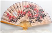 Sale 8644A - Lot 43 - An oversized Japanese fabric fan with cherry blossom design, length 150cm.