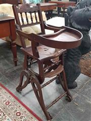 Sale 8917 - Lot 1053 - Antique American Walnut Metamorphic Childs High-Chair, with spindle back, tray table & converting to a pram