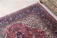 Sale 8963H - Lot 98 - A Persian wool carpet with blue medallion and pendants on a pink field with dark blue border, 257cm x 156cm