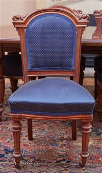 Sale 9080H - Lot 16 - A set of eight mahogany dining chairs with scrolled shoulders, the front turned legs terminating in castors, seat and back upholster...