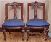 Sale 9080H - Lot 17 - A pair of antique occasional chairs with carved palmette to top rail and front legs with castors upholstered in a blue polka dot fab...