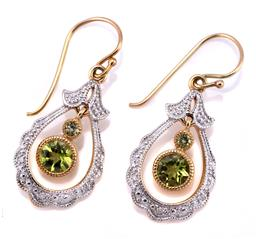 Sale 9145 - Lot 364 - A PAIR OF 9CT GOLD PERIDOT AND DIAMOND EARRINGS; elongated drops each with 2 articulating round cut peridots on a shepherds hook, le...