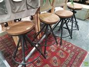 Sale 8601 - Lot 1503 - Set of Four Swivel Stools with Timber Seat & Black Tapering Legs