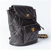 Sale 8891F - Lot 2 - A vintage Chanel quilted black leather backpack, with dustbag