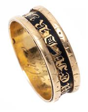 Sale 8982 - Lot 363 - A GEORGIAN 18CT GOLD MOURNING RING, 6.2mm wide band with black enamelled recessed channel, inside engraved To Helen Feb. 1845, hallm...