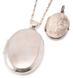 Sale 9149 - Lot 325 - TWO SILVER LOCKET PENDANTS AND CHAIN; plain oval locket with twin photo sections, length 53mm on a 2mm wide Gucci link chain to parr...