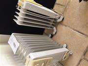 Sale 8866H - Lot 95 - Two oil filled radiators