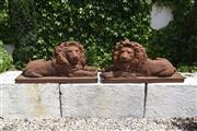 Sale 9087H - Lot 99 - A pair of large cast iron lions. 1.15m width, 45cm depth, 55cm height