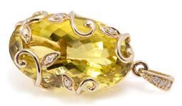 Sale 9160 - Lot 370 - A 9CT GOLD LEMON QUARTZ AND DIAMOND PENDANT; featuring an oval cut lemon quartz of approx. 24.70ct secured by 5 round brilliant cut...