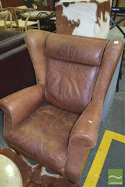Sale 8390 - Lot 1298 - Brown Leather Wing-Back Armchair