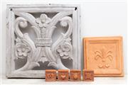 Sale 8644A - Lot 93 - A terracotta fleur-de-lis composite wall hanging (27x27cm) together with four terracotta wall tiles (7cm) and a plaster decorative w...