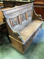 Sale 8666 - Lot 1090 - Late 19th/ Early 20th Century Flemish Oak Hall Seat, the back with inn scene panels, lion support arms, with hinged seat compartment...