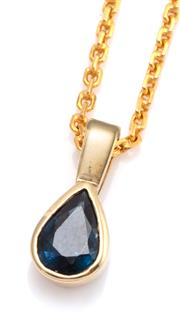 Sale 9095 - Lot 337 - A GOLD AND SAPPHIRE PENDANT NECKLACE; 14 x 6.mm 14ct gold pendant rub set with an approx. 0.90ct pear cut blue sapphire, wt. 1.05g o...