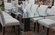 Sale 8782A - Lot 61 - A tempered glass top dining table by Milano Furniture with timber and chrome rectangular base. Height 74cm length 3oocm x width 100cm