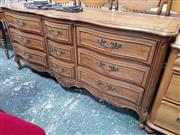 Sale 8868 - Lot 1047 - French Style Pollard Elm & American Oak Serpentine Fronted Sideboard, fitted with nine drawers & brass handles, by Thomasville