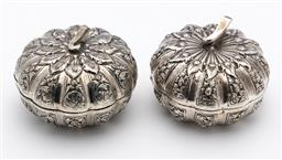 Sale 9245R - Lot 40 - A pair of vintage 900 grade silver lidded bowls in the formof pumpkins,the fluted panels profusely embossed with follliates, Ht: 6cm...