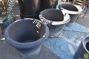 Sale 8390 - Lot 1359 - Three Black Painted Concrete Form Planters