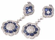 Sale 8954 - Lot 394 - A PAIR OF 14CT WHITE GOLD SAPPHIRE AND DIAMOND DOUBLE CLUSTER DROP EARRINGS; each a central cluster of 24 round brilliant cut diamon...