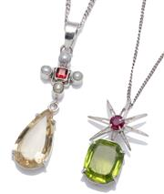 Sale 9012 - Lot 323 - TWO SILVER GEMSET PENDANT NECKLACES; a starburst bale centring a round cut treated ruby surmounting an emerald cut peridot of approx...