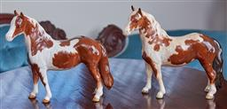 Sale 9103M - Lot 457 - A matched pair of Beswick glazed Skewbald horses, one repaired to front leg, Height 17cm