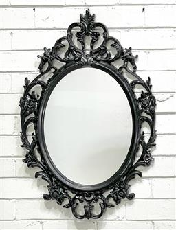 Sale 9108 - Lot 1016 - Shield shaped Mirror with Foliage and Scroll details (85 x 60cm) -