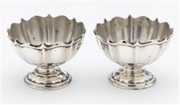 Sale 9245R - Lot 41 - A pair of English hallmarked sterling silver open salts, A & J Zimmerman, Birmingham 1905, the lobed octagonal bowls raised on a ste...