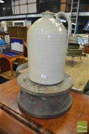 Sale 8440 - Lot 1043 - Potters Wheel and Demijohn