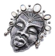 Sale 9012 - Lot 383 - A 1950S STERLING SILVER STONE SET BROOCH; mask of African lady with cabochon moonstone set headdress, retailed by Alan J Davis 50 C...