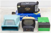 Sale 8644A - Lot 71 - A Polaroid 107mm camera together with a three slide viewers with examples by Hanorama, Marquis & Boots.