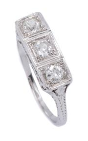 Sale 9012 - Lot 396 - A DECO STYLE THREE STONE DIAMOND RING; set in 18ct white gold cross the top with 3 Old European cut diamonds totalling approx. 0.60c...
