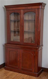Sale 9080H - Lot 35 - A Victorian mahogany bookcase/ display cabinet with two glazed doors over cupboard base presenting a shelved interior, total Height ...