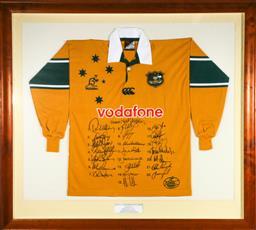 Sale 9156 - Lot 20 - Framed Wallabies 1999/2000 Jersey, signed (114cm x 125cm)