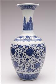Sale 9060 - Lot 91 - A Floral Decorated Blue And White Chinese Vase H: 38cm